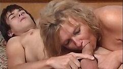 Brunette friend blowjobs her sons buddy