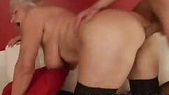 Busty grandma smiles and plays with him