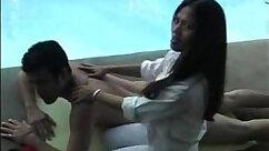 Busty secretary massaging huge dick