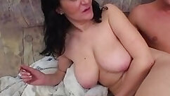 Busty mama riding cock and getting fucked