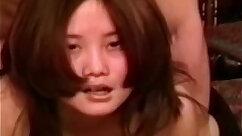 Asian amateur tittyfucks with anal plug