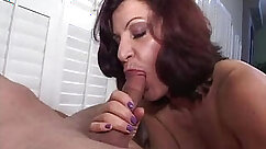 After sucking her pussy mommy gives deepthroat blowjob to Johnny Castle